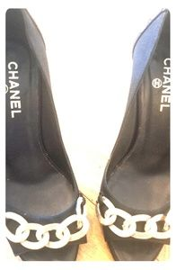 Chanel black leather & nylon pumps w/gold chain